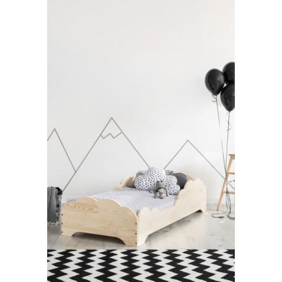 Moderná posteľ s obláčikovým rámom