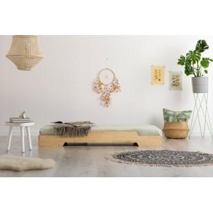 Jednoduchá posteľ v minimalistickom štýle