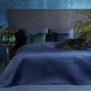 Tmavomodrý jednofarebný prešívaný prehoz na posteľ s ozdobou