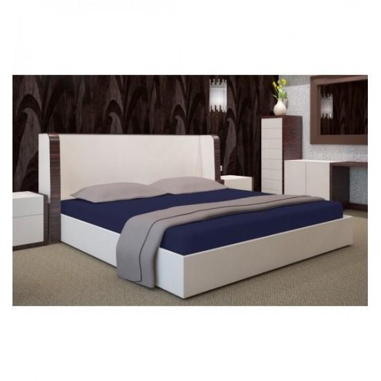 Tmavomodrá posteľná plachta s gumičkou Jersey
