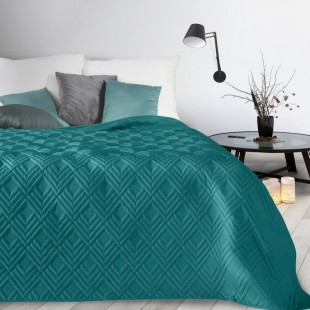 Modrý mäkký prehoz na posteľ so vzorom