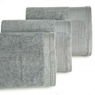 Sivý uterák z bavlny so striebornou ozdobnou časťou