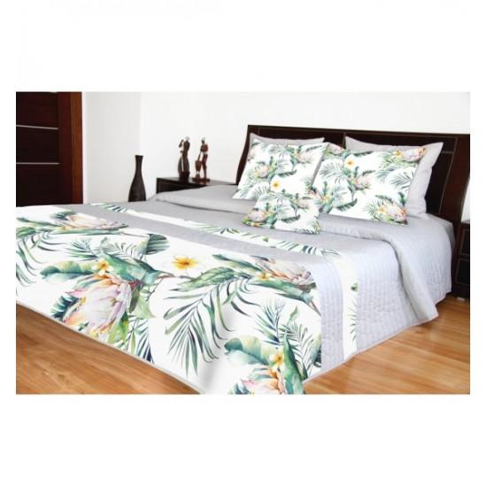 Sivý prešívaný prehoz na posteľ s kvetinovým motívom