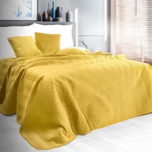 Žltý zamatový prehoz na posteľ s cik-cak prešívaním