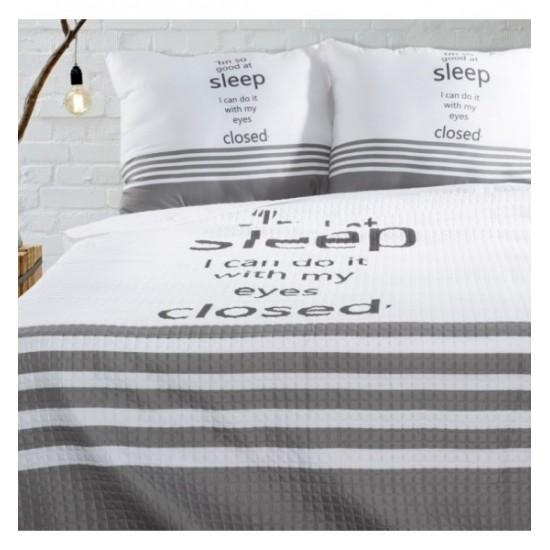 Moderný prešívaný prehoz na posteľ bielo sivej farby