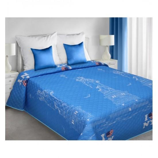Modrý prehoz na posteľ modrej farby s motívom Sochy slobody a New Yorku